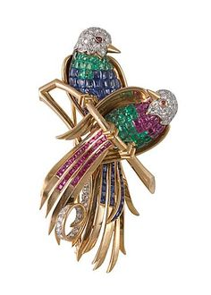 Paradise birds brooch in yellow gold and platinum set with invisibly set rubies,emeralds and sapphires the heads and the tails set with diamonds,french circa 1950