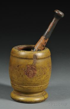 Mustard-painted Turned Wooden Mortar with a Porcelain and Wood Pestle, 19th century