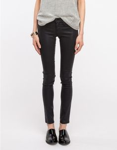 Low-rise, skinny leg, legging style denim with a leather-like coating for a lustrous finish. Features generous stretch. Made in USA.