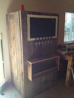 Kegerator wrapped in barn wood.