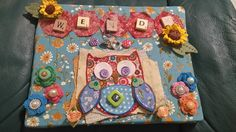 canvas pic did as part of the birthday pressie for my sis wendy. The canvas covered with material, owl die cut using new mixed media owl die by crafters companion , sunflowers last of stash from local craft shop bargain basket, crochet flowers given to me by very lovley crafty friends, letter tiles mix of wood and non wood and the rest bits and bobs really