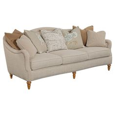 Sofa with turned legs and neutral upholstery.  Product: SofaConstruction Material: Hardwood solid, fabric and ve...