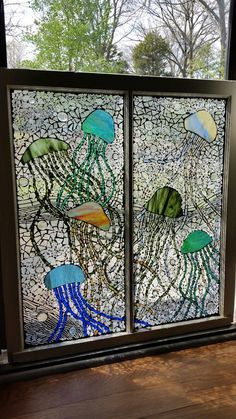 Jellyfish stained glass window by Chanda Froehle. More at www.facebook.com/GroovysquidGlass #glass #stained #mosaic #ocean #jellyfish #art #artist #unique #gift #louisville #kentucky #custom #window #stained #collectors #colors #louisville #kentucky