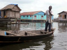 Ganvie village on Lake Nokoue near Cotonou, Benin, is famous for its waterways winding among bamboo houses on teak stilts.