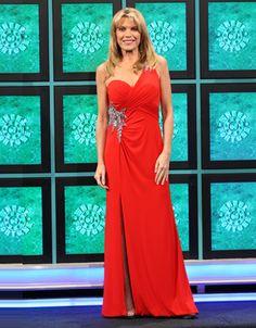 LA FEMME: Red jersey gown w/1-shoulder empire bodice shirred diagonally, aurora bead & rhinestone motifs on left shoulder & right hip, skirt slit on right-front, flared hemline
