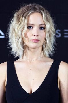 "J-Law has slowly been going blonder and blonder over the years, mixing up her [link url=""http://www.glamourmagazine.co.uk/gallery/blonde-hair-colours""]blonde shades[/link] and at the moment, she seems to be sticking to a white blonde colour which suits her perfectly. Like Cara, her shade is complimented by the cut of the season: the bob/lob."