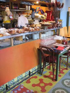 Saturnus Café, Stockholm  Saturnus Café, Stockholm, The most beautiful tiled floors by Cilla Ramnek. And the yummiest macaroons!