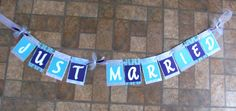 Just Married banner in turquoise, white, light gray and purple. Created by Banana Lala Party Designs & More
