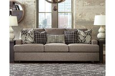 """Such a chic ensemble, this beautifully tailored piece was inspired by fashionable menswear. What looks like a """"gray flannel suit"""" suits the Gypsum sofa wonderfully well. We especially love the look of low-profile arms with a subtly sloped flair. Tweed-like upholstery—so soft and comfortable to the touch—suits so many styles perfectly."""