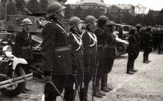 Vickers tanks on parade.In the background Church Skultes.Approximately 1935