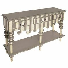 """Striped wood server with decorative apron and lower shelf.     Product: ServerConstruction Material: WoodColor: Cream and grey Features: Three drawers Lower shelf Dimensions: 40.25"""" H x 58.25"""" W x 17"""" D"""