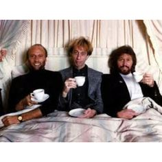 Bee Gees -  Barry, Robin, and Maurice Gibb - drinking tea to keep their vocal chords healthy!