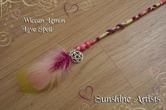 Wiccan Lemon Love Spell hair wrap, hair braid - witchcraft - yellow, pink, purple, gold - pony beads, pentagram charm and coloured feathers by SunshineArtists on Etsy