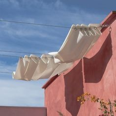This is a brillant idea for outdoor sun shades. Love it!
