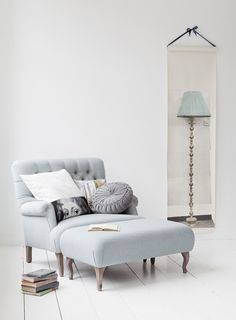 Oversize grey arm chair with large ottoman. Perfect for a reading spot.