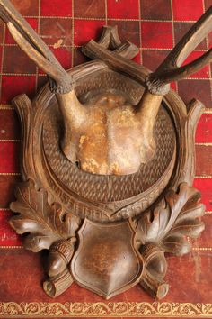 Antique 19th-century antlers on carved black-forest shield. Sold at: www.SpencerBros.co.uk. Antique taxidermy / hunting / shooting / deer / stag / mounted / plaque / shield / curiosity / curio / gentleman's library / rural / field sports / manor / country estate / house / interior design.