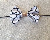 The Kate in Quatrefoil: Classic oversized black and white quatrefoil bow with gold center detail!