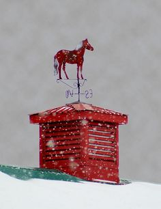 red horse weathervane on red chimney.  The colour looks great.