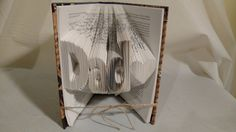 Folded Book Art-DAD-HEART-Book Sculpture-Book Decor-Book Shelf Decor-Library Decor-Handmade Book Decor-Book Art-Covered Book Art-Gift-Christmas Gift-Decorated Book Art-Upcycled Books-Repurposed Books  Great gift idea for friends, family, co-workers, book lovers and for yourself! This folded book was measured, folded and the cover was decorated in a fun color to fit in with any decor and finished with coordinating ribbon. Perfect for the bookworm in your life!  My folded book art is made…