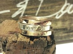 Sterling band stamped & with a yellow 14k gold heart, surrounded with a yellow gold filled band on the bottom and a rose gold filled band on the top