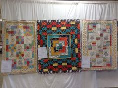 Jackson's crib quilt in center. Twins embroidery keepsake quilts