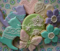 Gorgeous, adorable, spring cookies with pearls, flowers, butterflies and pussycats in lace!!
