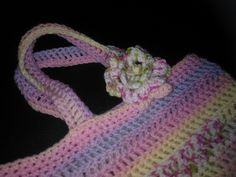 A gift bag for my Niece's Birthday present  with crochet flower detail.