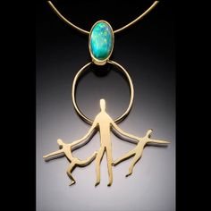 Which Way a figurative pendant of 18k gold and opal