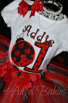 3 Piece Lady Bug Red First Birthday LADYBUG Glitter Tutu Outfit with Onesie, Headband, and Tutu Choose Size with Embroidered Name. $52.75, via Etsy.