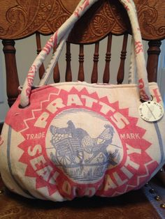 Vintage Pratts feed sack Carpetbag. www.ginnymae.etsy.com