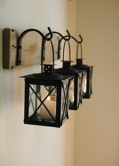 Black Lantern Trio Wall Decor, Home Decor, Rustic Decor, hanging from wrought iron hooks on wood board - Fenster Black Lantern, Rustic House, Decor, Wrought Iron, Wrought Iron Decor, Lanterns Decor, Glass Lantern, Rustic Decor, Home Decor