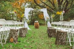 Stump with white chairs (just like ours will be) only place candles in mason jars and spanish moss or tuille on top to help soften