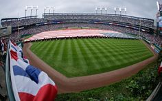American flag is displayed on the field during the national anthem before Game 3 of the American League championship series