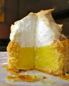 Lemon Meringue Nests - the recipe uses Pepperidge Farm Puff Pastry Shells, Royal Lemon Pie Filling Mix, and a meringue topping for an impressive dessert in no time!
