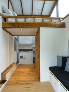 The Lumber Loft: a cabin-style tiny house on wheels, designed for glamping!