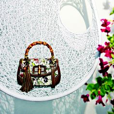 Gucci New Bamboo Flora Canvas Top Handle Bag. Flora was initially created for Grace Kelly in 1966.