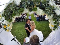 """You may now kiss the bride! Groom Brian Kamilar says of this special shot, """"My buddies hid a GoPro in the flowers of our wedding alter. We had no idea it was there, and before we got down the aisle they had posted it on online from their phone and tagged all our friends. Best day ever."""""""