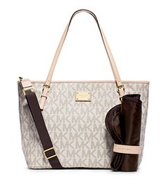FYI - This could be a great photography bag with all the little compartments in it. The bottle pockets could fit lenses. The Jet Set Travel diaper bag offers a fashionable take on a tried-and-true staple. Stow all of your necessities, along with the provided changing pad, in the spacious interior and multiple elastic pockets. Carry it by the top handles or sling the sturdy adjustable strap over your shoulder for fuss-free fashion.