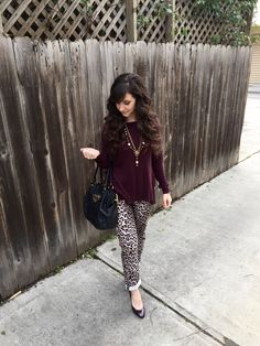 A ruffled purple sweater paired with leopard pants, purple heels and a statement necklace By Elizabeth Morgan
