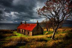 Suisnish Ruin, and the distant Isle of Rum. Isle of Skye. Scotland.