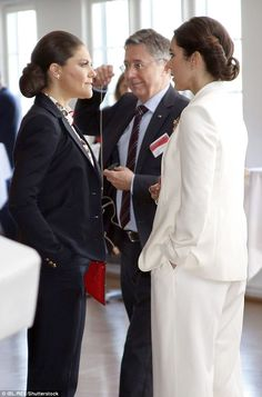 The two princesses were almost a mirror images of one another as they chatted at a recepti...