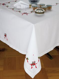 Candy Cane - Fine #Table #Linens - Bring the joy of the season to your dining table with this meticulously hand embroidered #tablecloths, #placemats, #napkins and cocktail napkins. Striped candy canes and shiny green holly are bound together with graceful Red ribbons on crisp, White 100% Italian linen. This import was designed to trim your most memorable holiday gatherings in dazzling color and cheer. #luxury