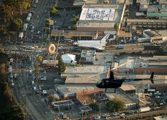 Space shuttle Endeavour is seen next to the Randy's Donuts landmark in Inglewood, Calif., in this view from the Goodyear blimp, Friday, Oct. 12, 2012. Space Shuttle Endeavour Move (201210120012HQ)
