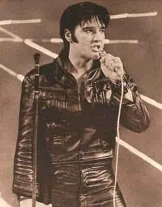 elvis in his '69 comeback concert, watched on tv. slim and trim but didn't last long. really sad. had the world by the balls and just couldn't deal with it..mg