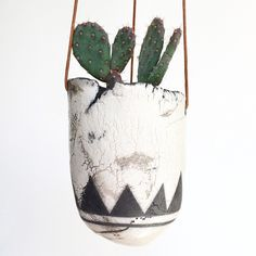 Raku Hanging Planter. This planter I've kept in my personal collection where it hangs beautifully in my dining room window. #Raku #rakuart #rakufire #ceramics #pottery #myart #handmade #highyieldstudio #planter #hangingplanter #cactus #succulents #airplants #flowers #plants #minimalist #minimalistart #minimalistdesign #decor #artdecor #homedecor #gardendecor #mountains #triangles #geometricdesign #interiordesign #blackandwhite