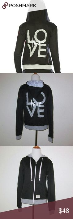 Peace Love World True Love Hoodie Our Love Life Hoodie begins with a roomy, contrast-color drawstring hood, followed with a trim body with a standard length down to a bound lower hem, and long sleeves with dedicated thumbholes at the cuff. Metal zipper front with PLW pull, a subtle PLW patch at lower right, and an inspirational Love Quote inscribed at the hood's right side. On back, an oversized ?True Love? Graphic is printed across bottom center.  Condition: Hoodie is clean and shows…