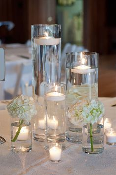 Hovering unscented candles really are a fantastic way to add that designer's feel to effectively plates, centerpieces and bud vases. Just apply plants, portion pieces or dyed plain water. Floating Candles Wedding, Floating Candle Centerpieces, Wedding Reception Centerpieces, Wedding Table Centerpieces, Centerpiece Decorations, Wedding Decorations, Cheap Centerpiece Ideas, No Flower Centerpieces, Cheap Table Decorations