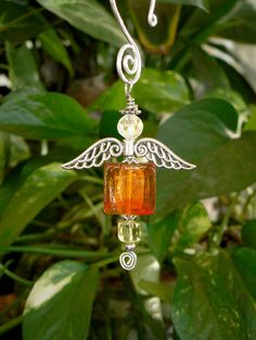 Hand blown orange and red glass beaded hanging angel by LindaGillottiDesigns on Etsy