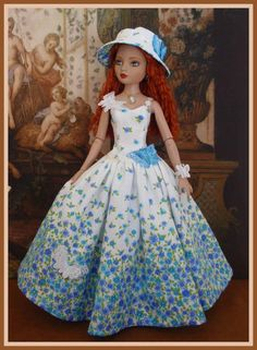 """Estrella (Nevermore doll) is wearing """"Flowers and Butterflies"""" - an outfit created by Inma's Doll Collection. #Ellowyne #blue #floral"""