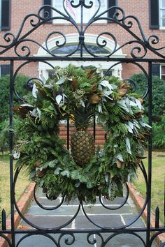 Charleston Daily Photo: December 2010.....old tradition in Charleston....when the residents were at home following a voyage they added a pineapple at the gate to welcome friends....lovely idea in this Christmas wreath.
